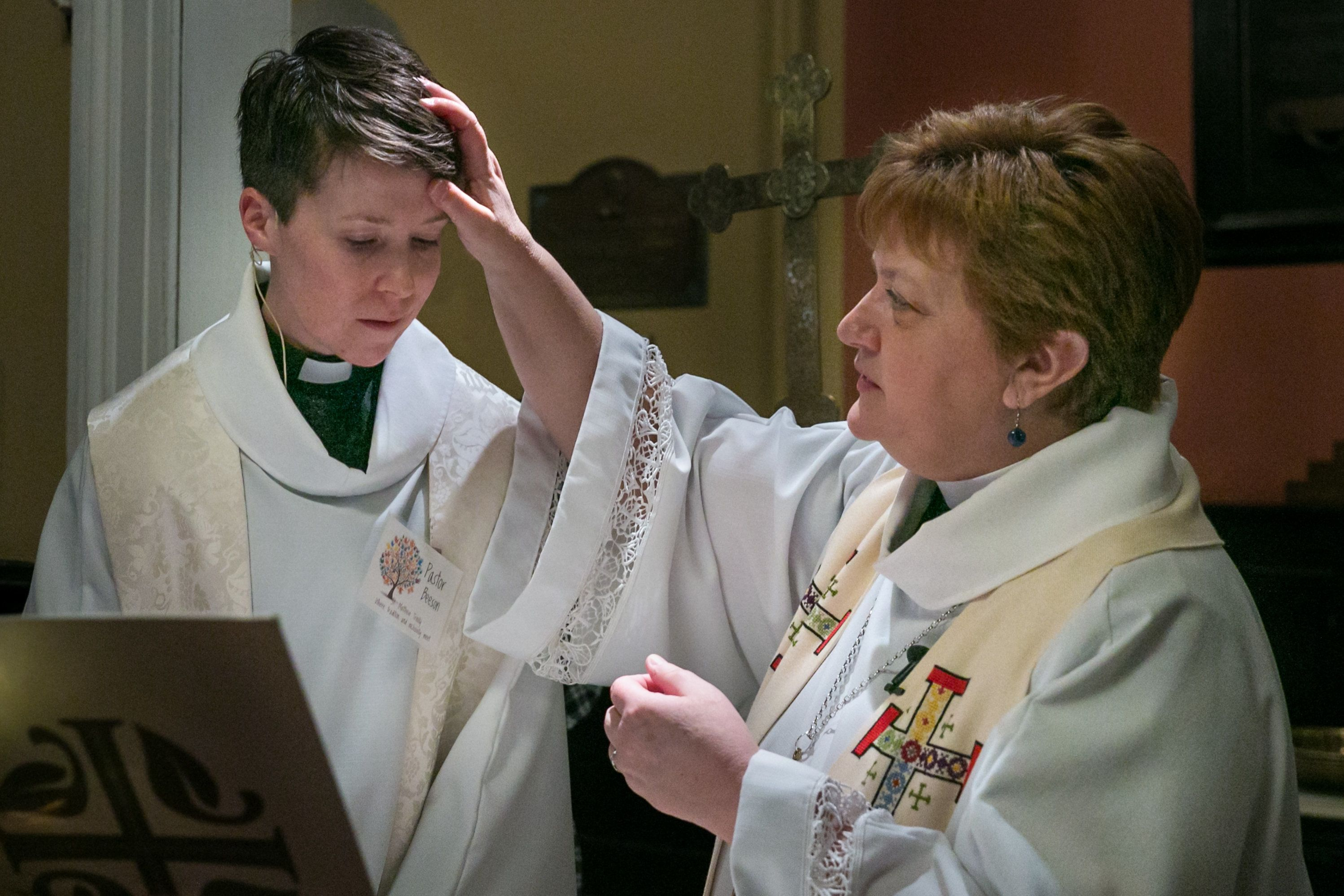 New Jersey Synod Bishop Tracie Bartholomew blesses Rev. Peter Beeson at St. Matthew Trinity Lutheran Church's baptismal