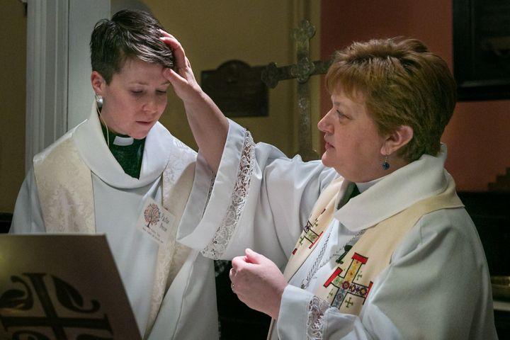 New Jersey Synod Bishop Tracie Bartholomew blessesRev. Peter Beeson at St. Matthew Trinity Lutheran Church's baptismal