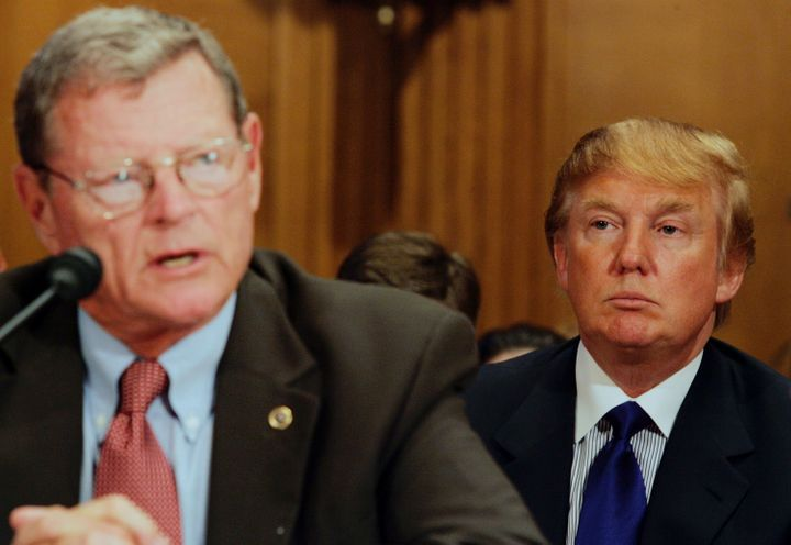 In a photo from July 2005, Donald Trump (R), then president of the Trump Organization, listens as Sen. James I