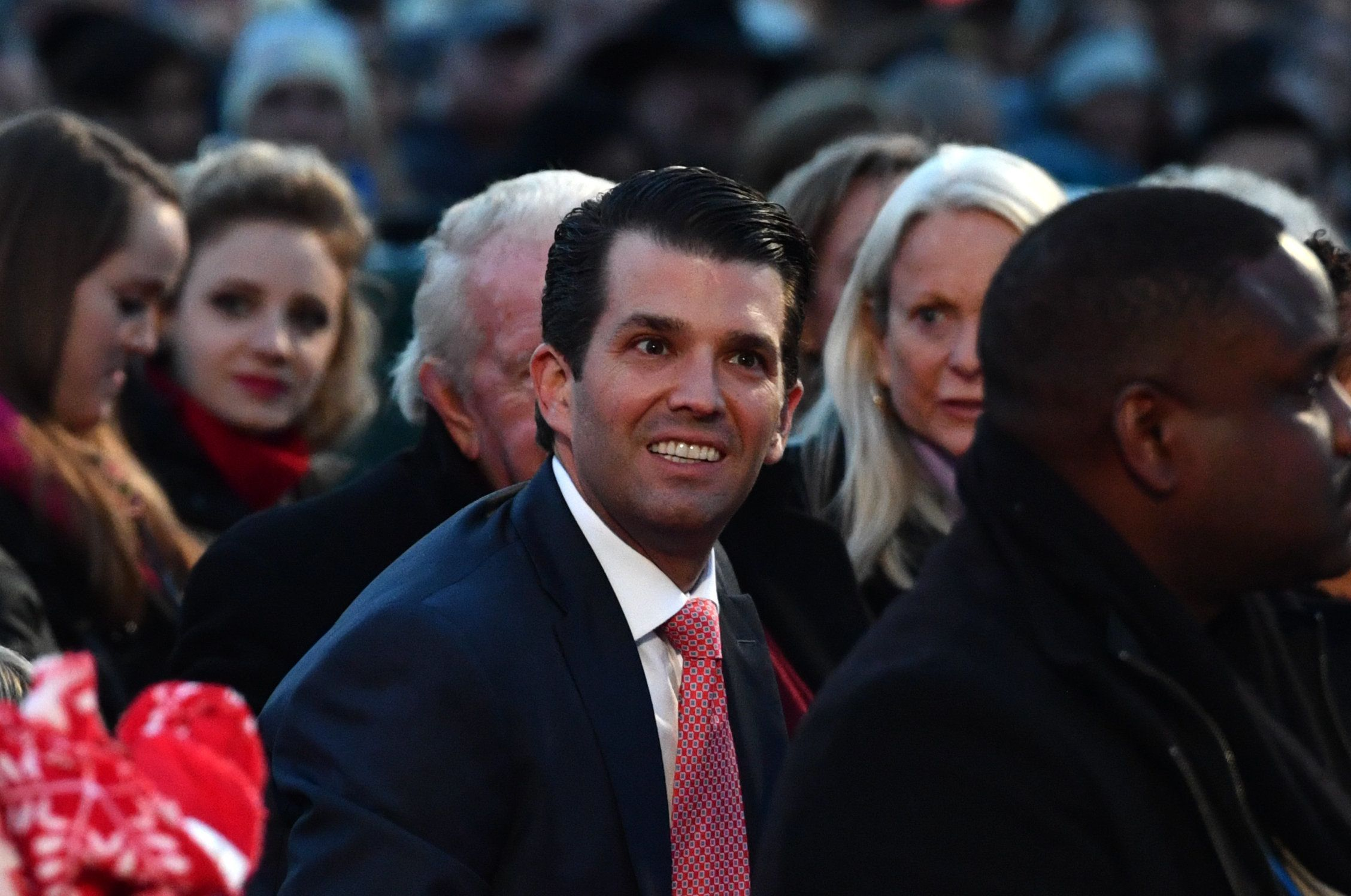 Donald Trump Jr. smiles as he waits for the arrival of US President Donald Trump before the 95th annual National Christmas Tree Lighting ceremony at the Ellipse in President's Park near the White House in Washington, DC on November 30, 2017. / AFP PHOTO / Nicholas Kamm        (Photo credit should read NICHOLAS KAMM/AFP/Getty Images)