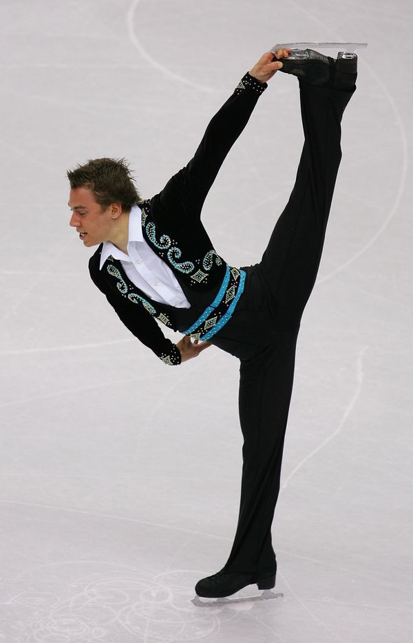 The Canadian competes in the men's short program figure skating at the Turin 2006 Winter Olympic Games.