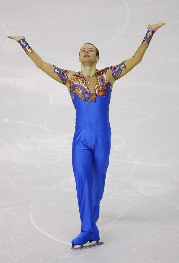 Competing in the men's short program for Russia at the Palavela in Turin, Italy.