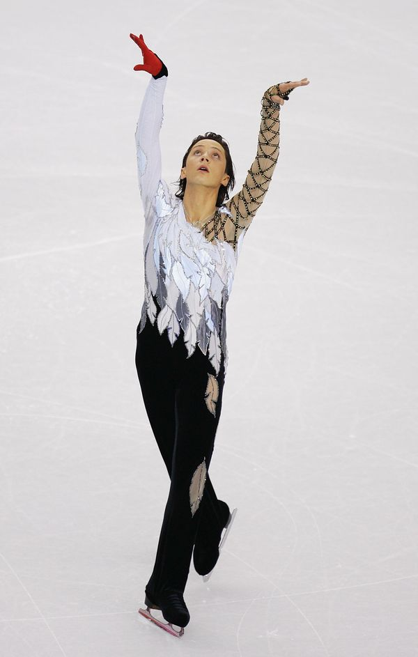 The U.S. skater competes in the men's short program at the Turin 2006 Winter Olympic Games.