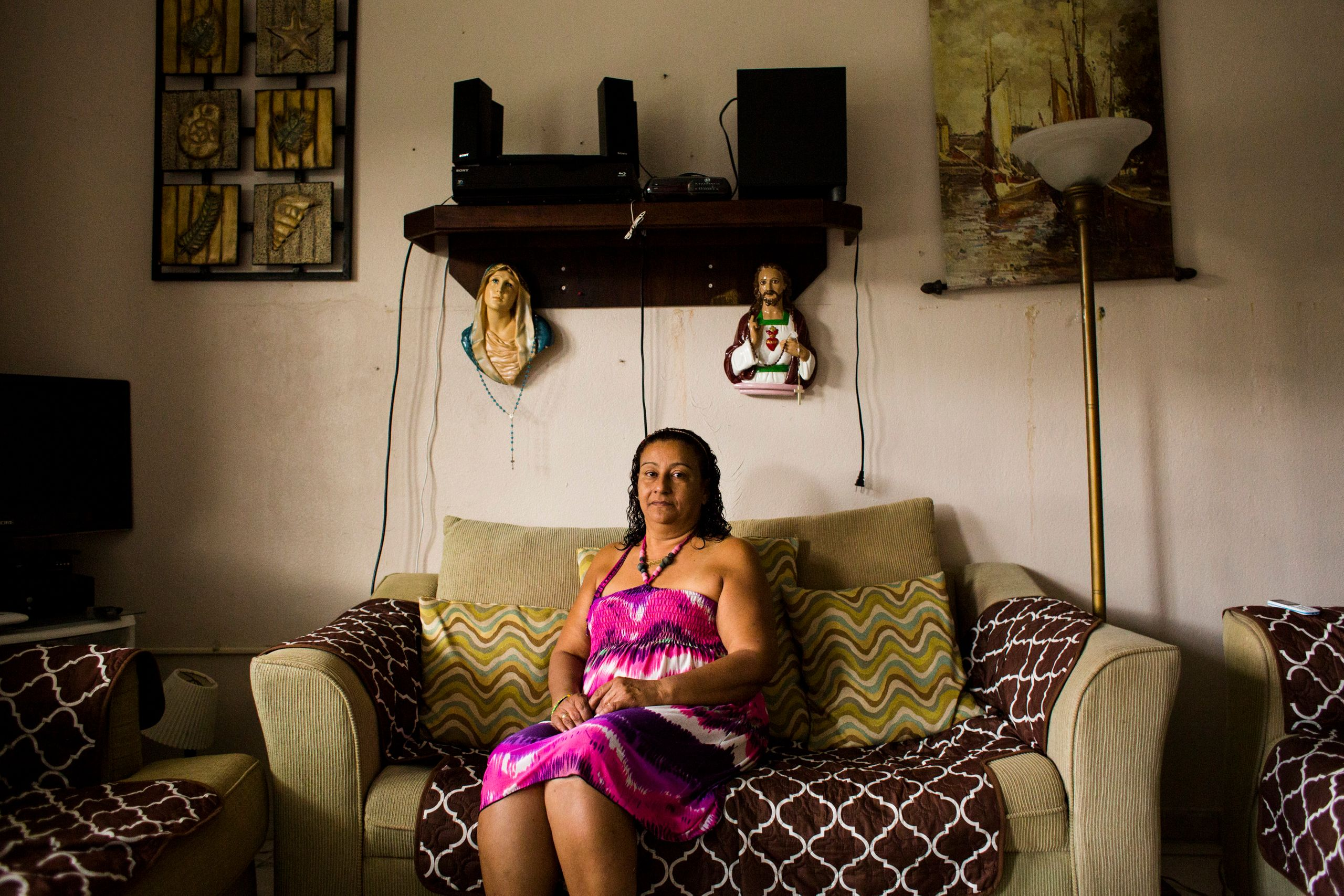Carmen Bonilla Ramos sits at her home in the mountains of Rincón, Puerto Rico