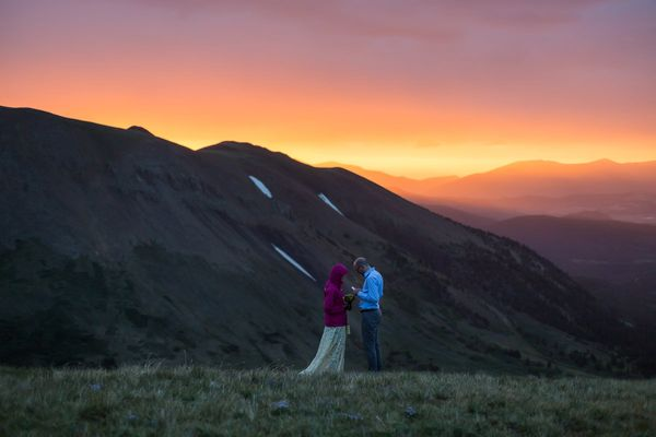 """This couple wanted to elope on Colorado's Black Powder Pass at sunrise, which meant hiking up in the dark. There was quite a"