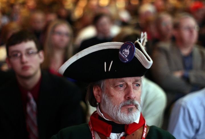 A tea party activist waits for Sen. Marco Rubio to deliver a speech during the annual Conservative Political Action Conferenc