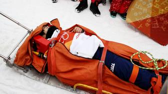 PYEONGCHANG-GUN, SOUTH KOREA - FEBRUARY 14:  Yuto Totsuka of Japan is stretched off by medical staff after crashing in the during the Snowboard Men's Halfpipe Final on day five of the PyeongChang 2018 Winter Olympics at Phoenix Snow Park on February 14, 2018 in Pyeongchang-gun, South Korea.  (Photo by Cameron Spencer/Getty Images)