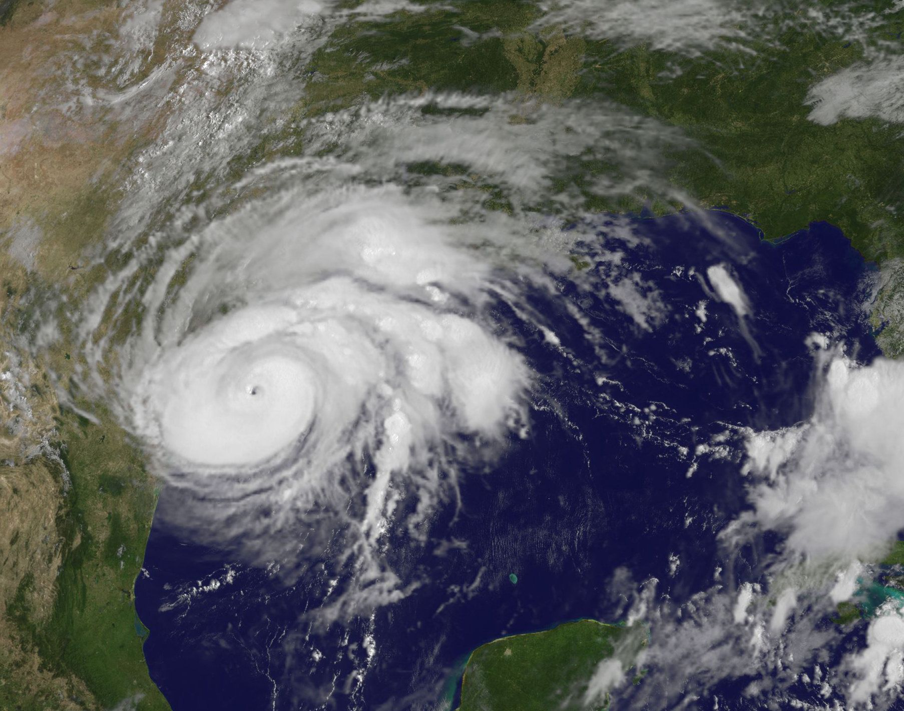 UNITED STATES - AUGUST 25: In this NOAA handout image, NOAA's GOES East satellite capture of Hurricane Harvey shows the storm's eye as the storm nears landfall at 10:07 a.m. EDT (1407 UTC) on August 25, 2017 in the southeastern coast of Texas. (Photo by NASA/NOAA GOES Project via Getty Images)