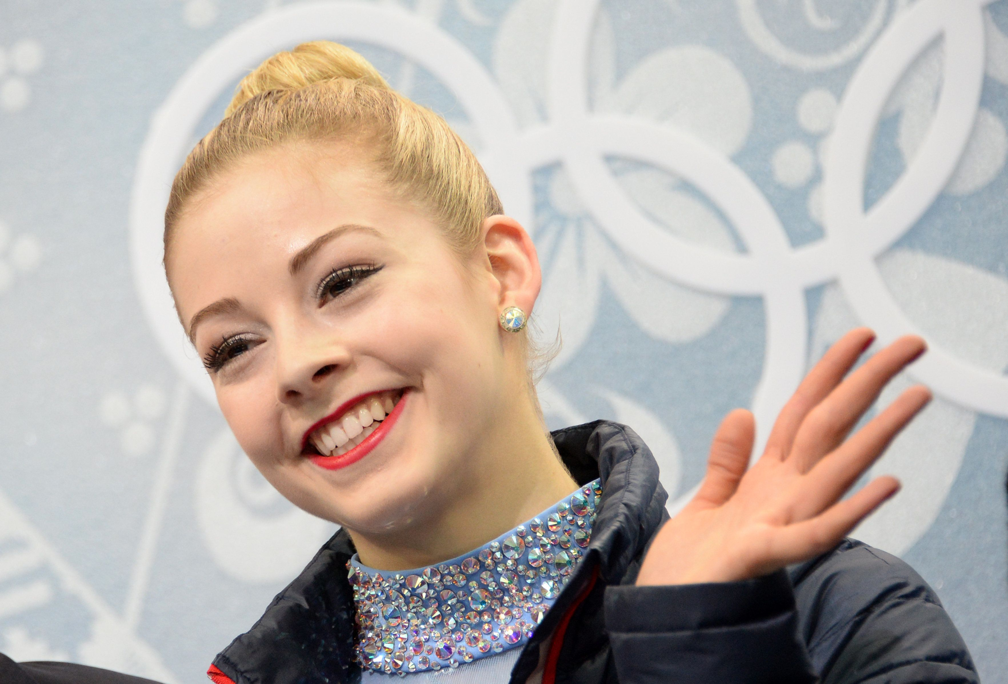 US Gracie Gold smiles in the kiss and cry zone during the Women's Figure Skating Free Program at the Iceberg Skating Palace during the Sochi Winter Olympics on February 20, 2014.  AFP PHOTO / DAMIEN MEYER        (Photo credit should read DAMIEN MEYER/AFP/Getty Images)