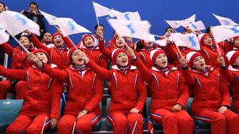 Ice Hockey – Pyeongchang 2018 Winter Olympics – Women Preliminary Round Match - Korea v Japan - Kwandong Hockey Centre, Gangneung, South Korea – February 14, 2018 - North Korean cheerleaders. REUTERS/Lucy Nicholson