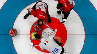 Curling - Pyeongchang 2018 Winter Olympics - Men's Round Robin - Canada v Italy - Gangneung Curling Center - Gangneung, South Korea - February 14, 2018 - Amos Mosaner of Italy, and Brent Laing and Ben Hebert  of Canada. REUTERS/Cathal McNaughton
