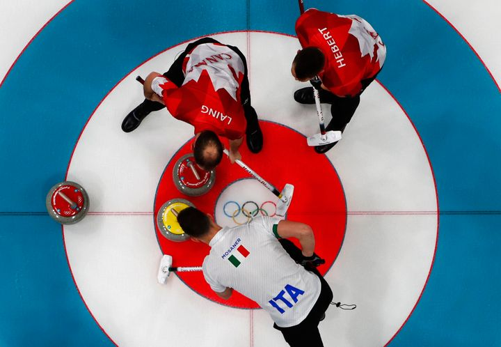 Brent Laing and teammate Ben Hebert in the Canada vs. Italy in curling competition on Wednesday.