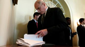 White House Chief of Staff John Kelly looks through papers as U.S. President Donald Trump holds a meeting on trade with members of Congress at the White House in Washington, U.S., February 13, 2018. REUTERS/Kevin Lamarque