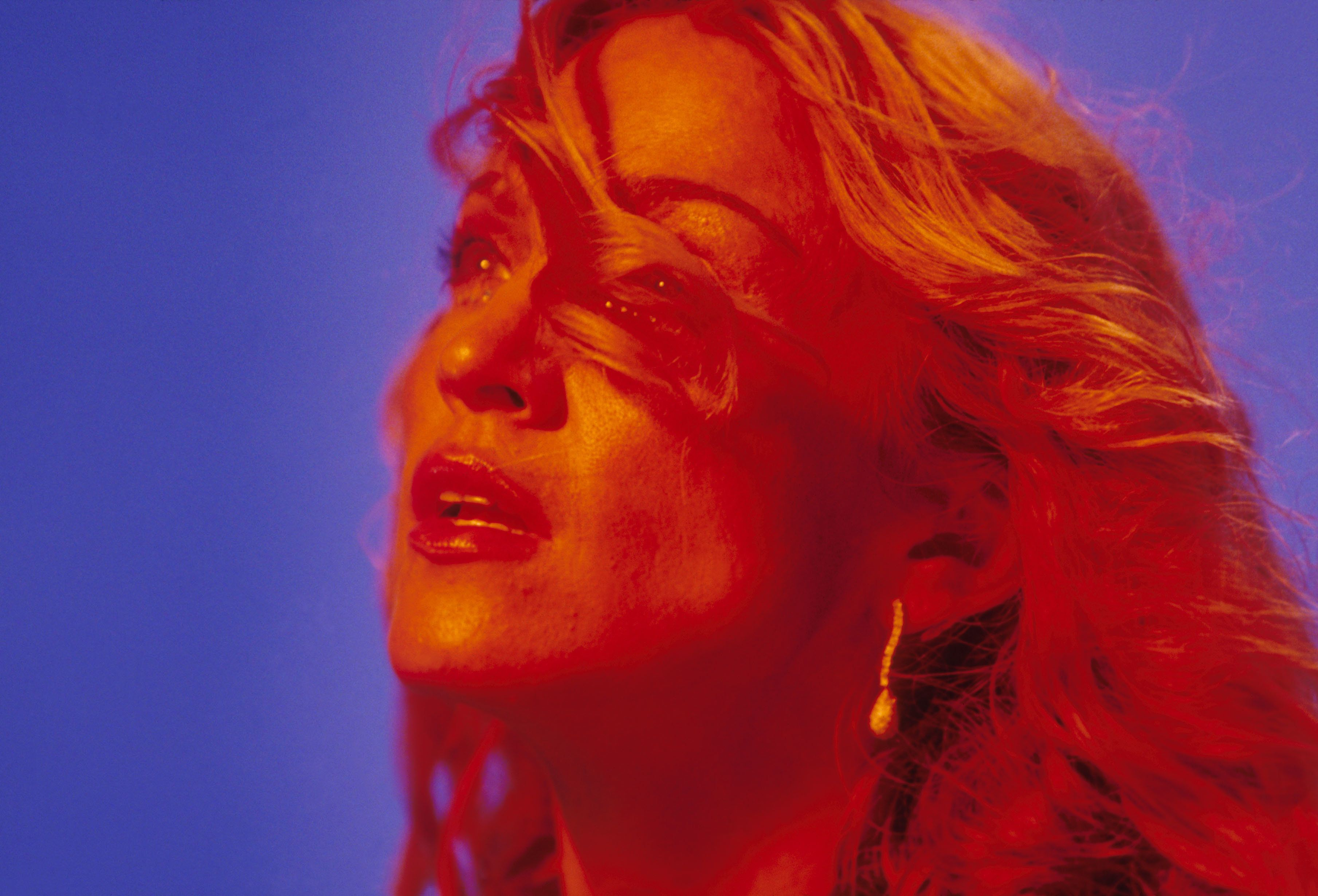 """Madonna on the set of her """"Ray of Light"""" music video."""