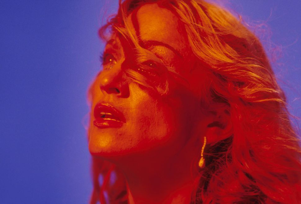"Madonna on the set of her ""Ray of Light"" music video."