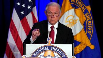 U.S. Attorney General Jeff Sessions delivers remarks on law enforcement efforts to combat the opioid crisis and violent crime in an address before the National Sheriffs Association Winter Conference in Washington, U.S., February 12, 2018. REUTERS/Yuri Gripas