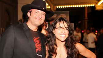 Director Robert Rodriguez and Actress Michelle Rodriguez attend the Austin Screening of 'Machete' at The Paramount Theater on September 2, 2010 in Austin, Texas.
