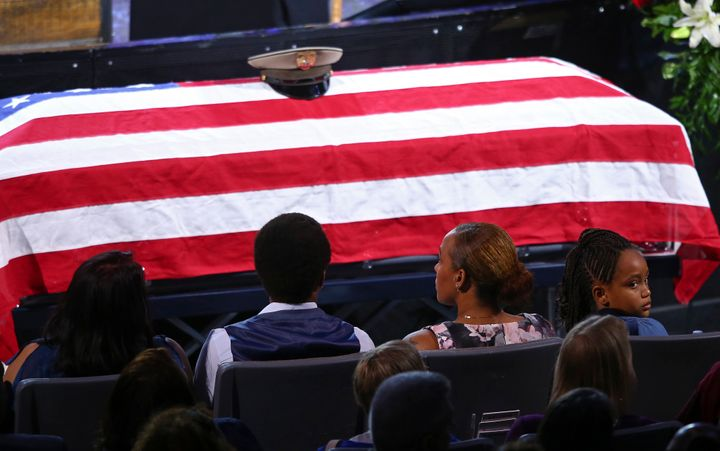 Family members at the Oct. 20 funeral of Las Vegas police officer Charleston Hartfield, who was among the 58 people killed by