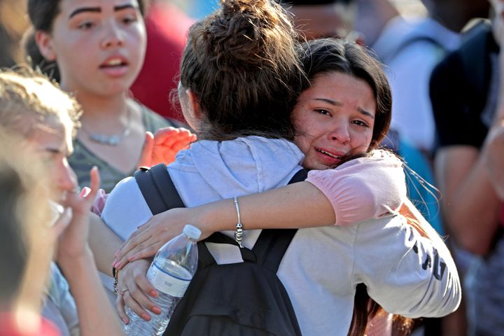 Students embrace after being released from a lockdown during Wednesday's shooting.
