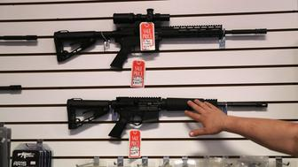 BENSON, AZ - SEPTEMBER 29:  Gun shop owner Jeff Binkley displays AR-15 'Sport' rifles at Sarge's Sidearms on September 29, 2016 in Benson, Arizona. He said he redesigned and renamed his store just this year. Gun shops are proliferate in Arizona, which regulates and restricts weapons less than anywhere in the United States.  (Photo by John Moore/Getty Images)