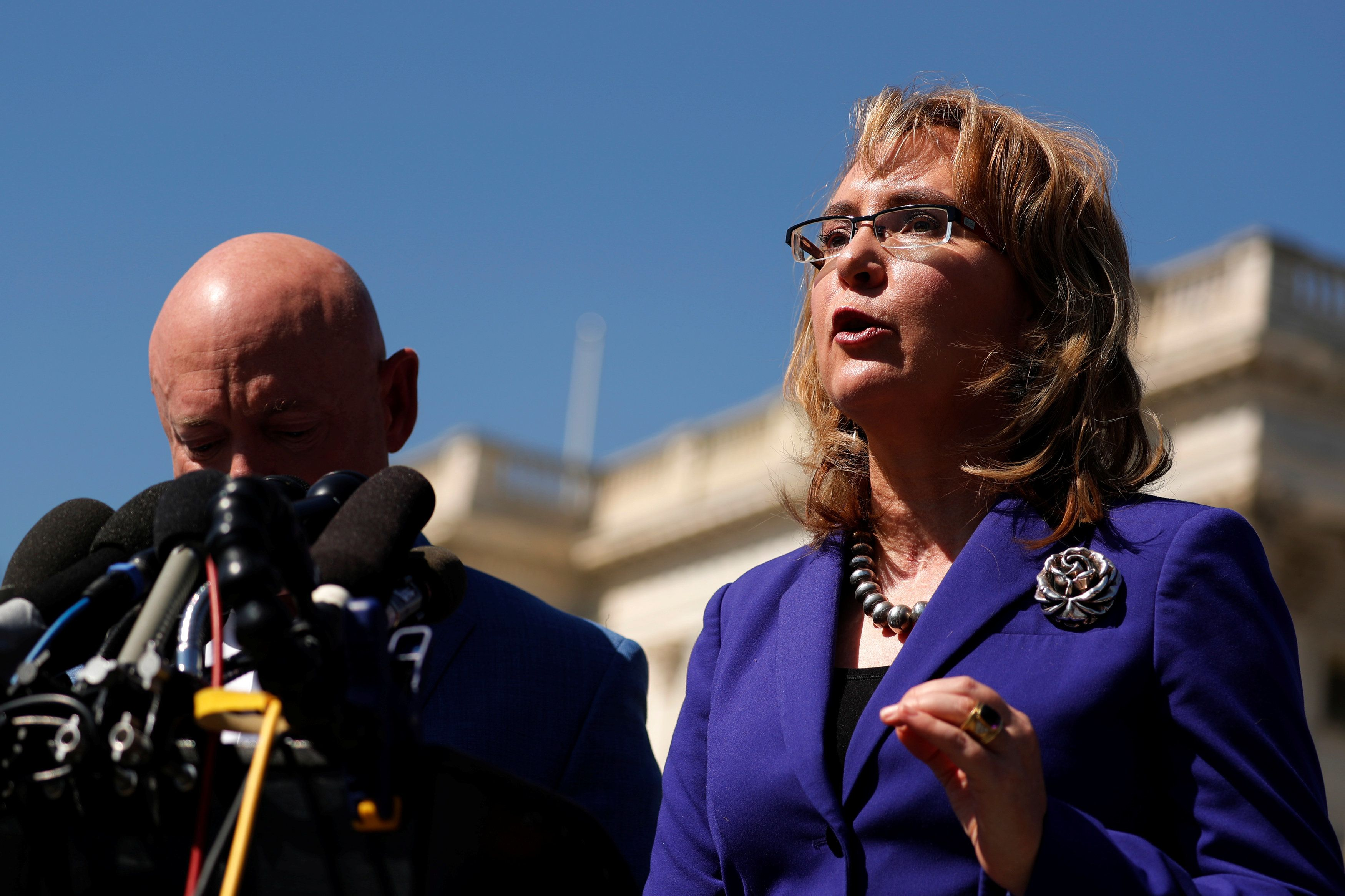 Former U.S. Representative Gabrielle Giffords (D-AZ), with her husband retired U.S. astronaut Mark Kelly, addresses reporters about the deadly shootings in Las Vegas, from a lectern outside the U.S. Capitol in Washington, U.S. October 2, 2017. REUTERS/Jonathan Ernst
