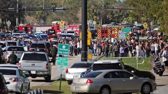 Students are brought across Coral Springs Drive from the the campus of Stoneman Douglas High School in Parkland, Fla., after a shooting on Wednesday, Feb. 14, 2018. (Amy Beth Bennett/Sun Sentinel/TNS via Getty Images)