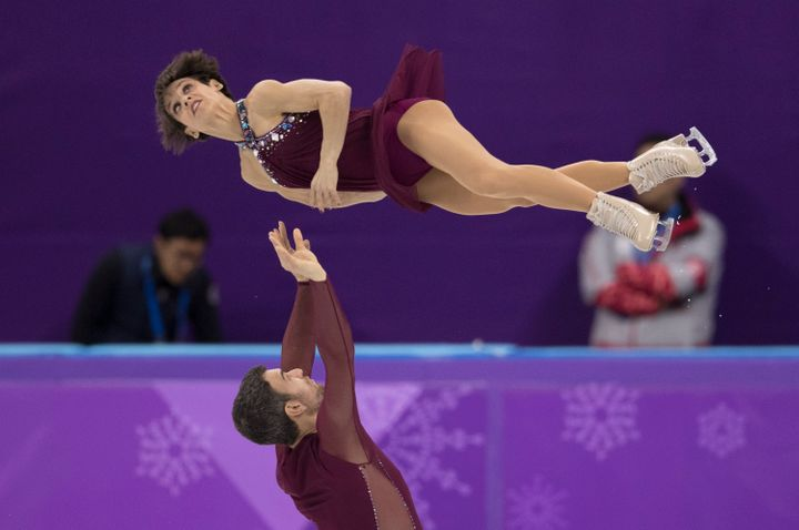 Eric Radford and Meagan Duhamel compete in the pair skating free skating.