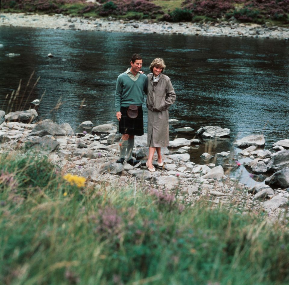 The newlyweds by the river at Balmoral after returning from their cruise of the