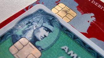 Computer chips are seen on newly-issued credit cards in this photo illustration taken in Encinitas, California September 28, 2015. In an effort to reduce counterfeit and credit card fraud more than 200 million payment cards have been issued with embedded computer chips in the U.S., ahead of a Oct. 1 deadline for the switch to such cards, according to the Smart Card Alliance. Credit card companies have set the October deadline which will require U.S. consumers to carry a new kind of card and retailers across the nation to upgrade payment terminals.  REUTERS/Mike Blake