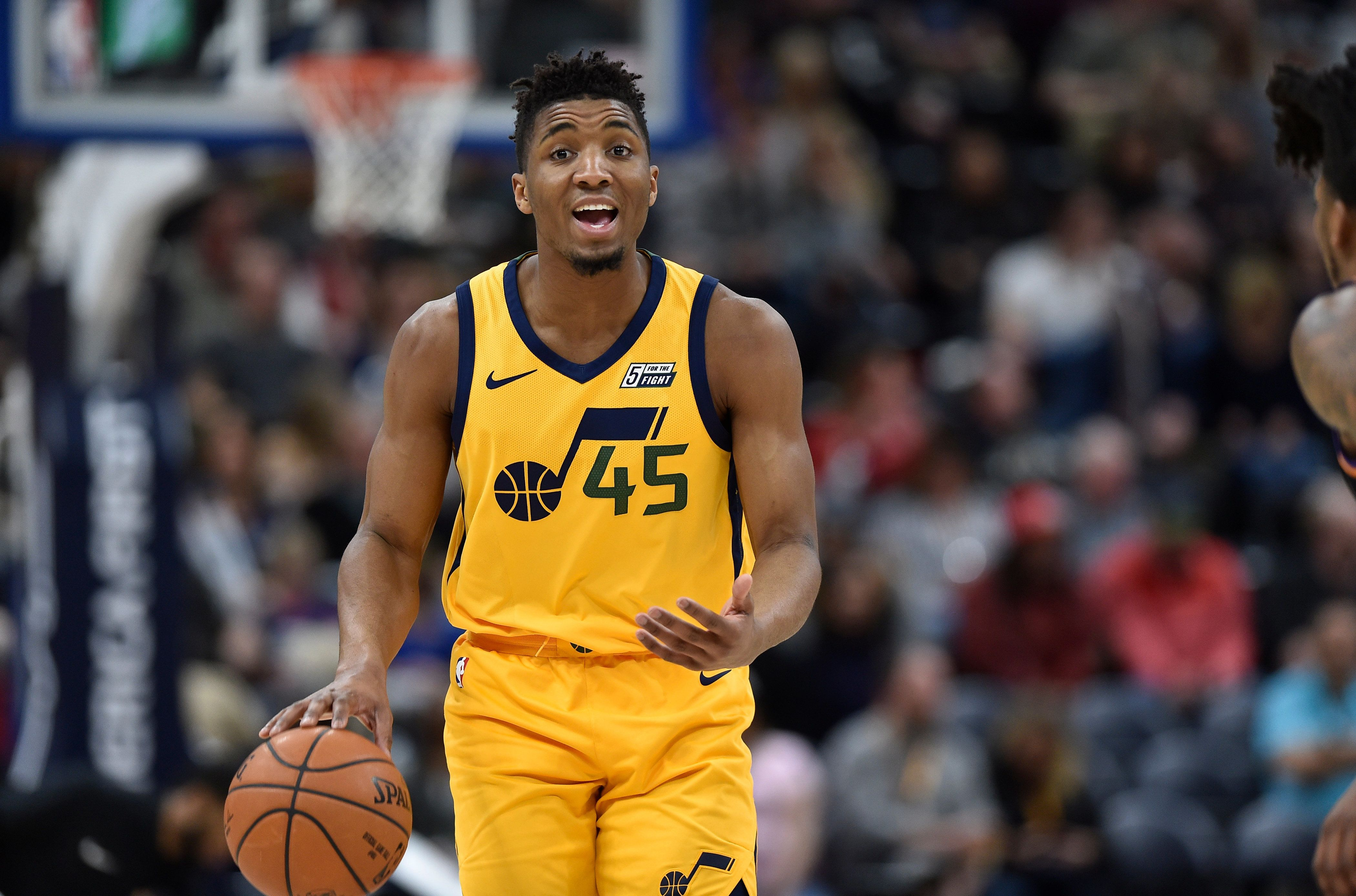 SALT LAKE CITY, UT - FEBRUARY 14: Donovan Mitchell #45 of the Utah Jazz brings the ball up court during the first half of a game against the Phoenix Suns at Vivint Smart Home Arena on February 14, 2018 in Salt Lake City, Utah. NOTE TO USER: User expressly acknowledges and agrees that, by downloading and or using this photograph, User is consenting to the terms and conditions of the Getty Images License Agreement. (Photo by Gene Sweeney Jr./Getty Images)