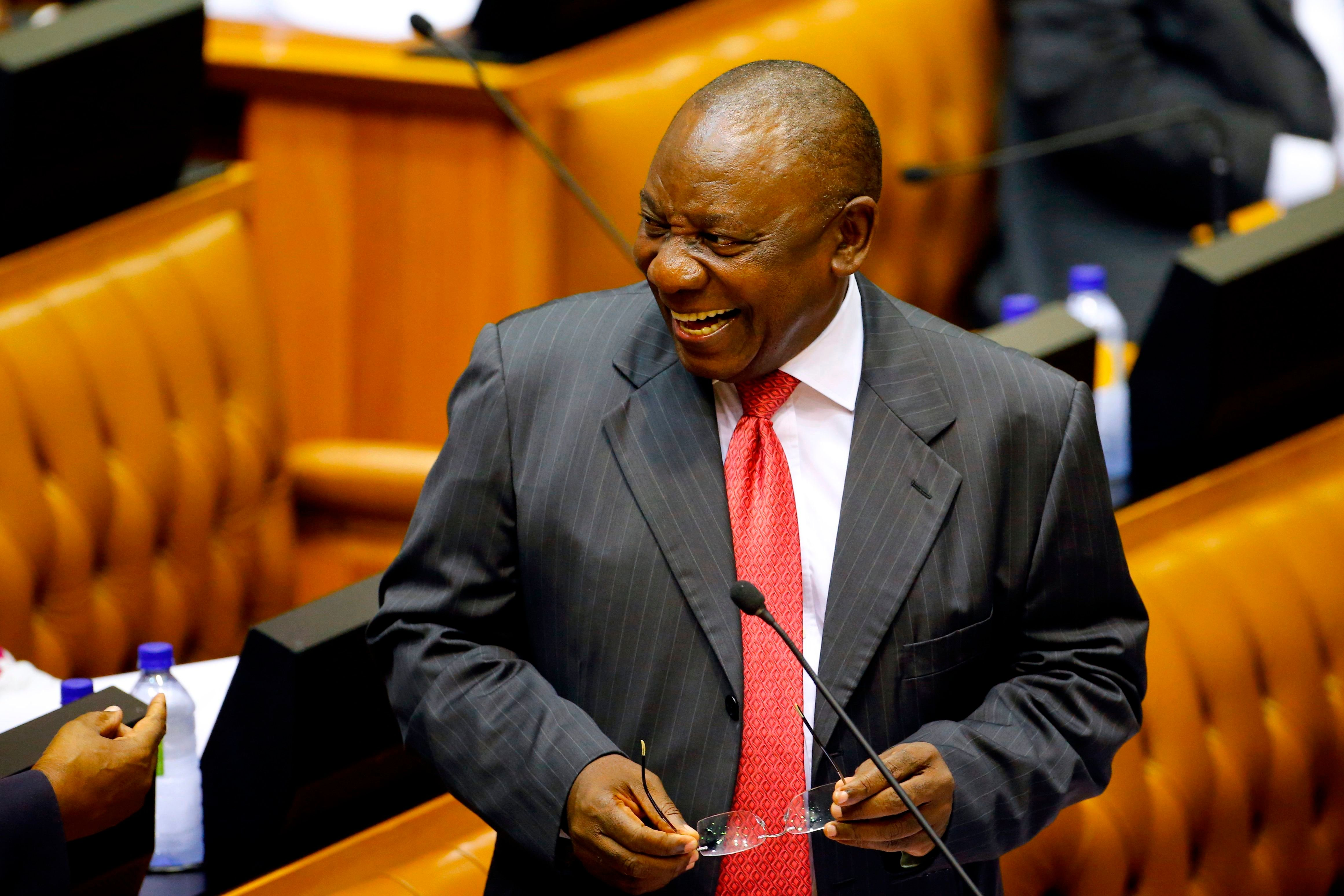 Acting President of South Africa Cyril Ramaphosa reacts as he arrives at Parliament in Cape Town, on February 15, 2018 for a session to officially deal with former President Zuma's resignation and his possible election and swearing. South Africa prepared to welcome wealthy former businessman Cyril Ramaphosa as its new president on February 15, 2018 after scandal-tainted Jacob Zuma resigned under intense pressure from his own party. / AFP PHOTO / POOL / MIKE HUTCHINGS        (Photo credit should read MIKE HUTCHINGS/AFP/Getty Images)