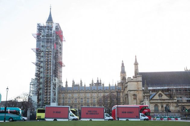 The billboards were paraded through central London before arriving at the scene of the fire in North