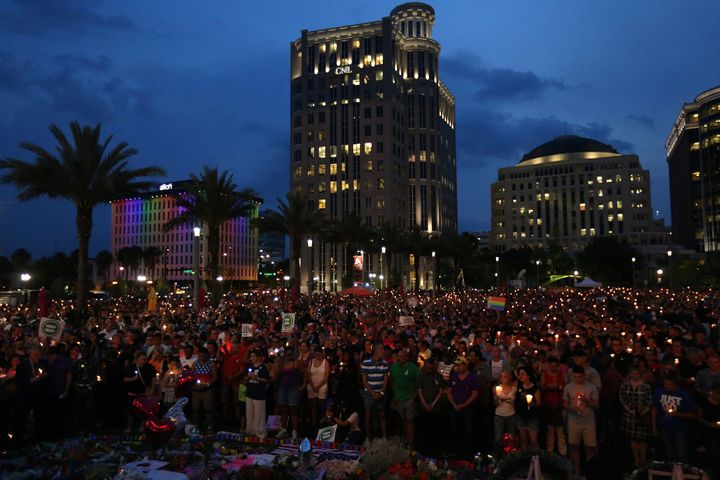 People take part in a candlelight memorial service the day after the mass shooting at the Pulse nightclub in Orlando, Florida
