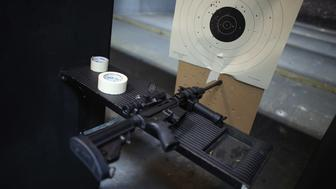 POMPANO BEACH, FL - APRIL 11:  As the U.S. Senate takes up gun legislation in Washington, DC , an AR-15 semi-automatic rifle is seen next to a target in the indoor gun range at the National Armory gun store on April 11, 2013 in Pompano Beach, Florida. The Senate voted 68-31 to begin debate on a bill that would significantly expand background checks for gun sales.  (Photo by Joe Raedle/Getty Images)