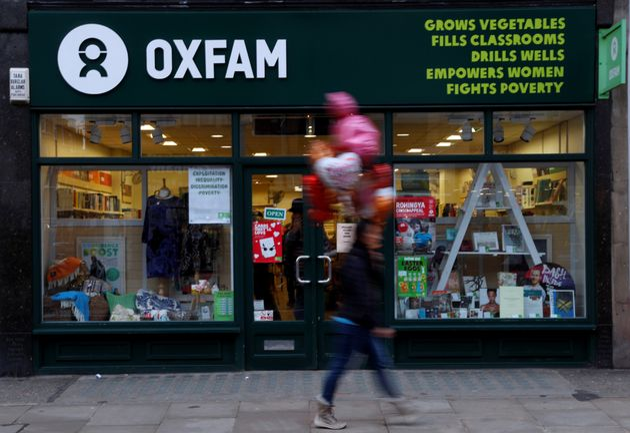 A pedestrian walks past a branch of Oxfam in