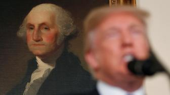 U.S. President Donald Trump speaks about Iran and the Iran nuclear deal in front of a portrait of President George Washington in the Diplomatic Room of the White House in Washington, U.S., October 13, 2017. REUTERS/Kevin Lamarque