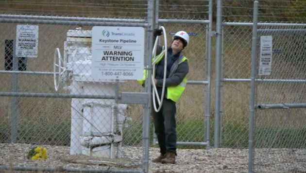 A screenshot of Michael Foster turning the valve on the Keystone