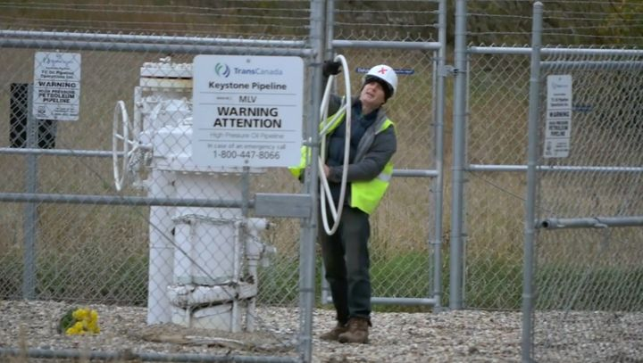 A screenshot of Michael Foster turning the valve on the Keystone Pipeline.