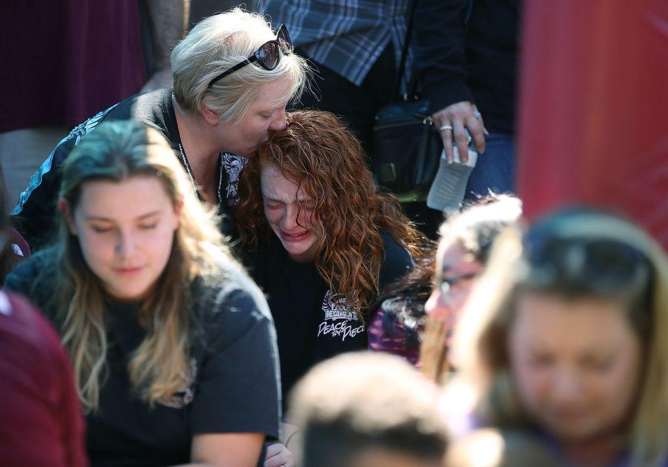 Alyssa Kramer, 16, gets a hug from her mother, Tonja Kramer.