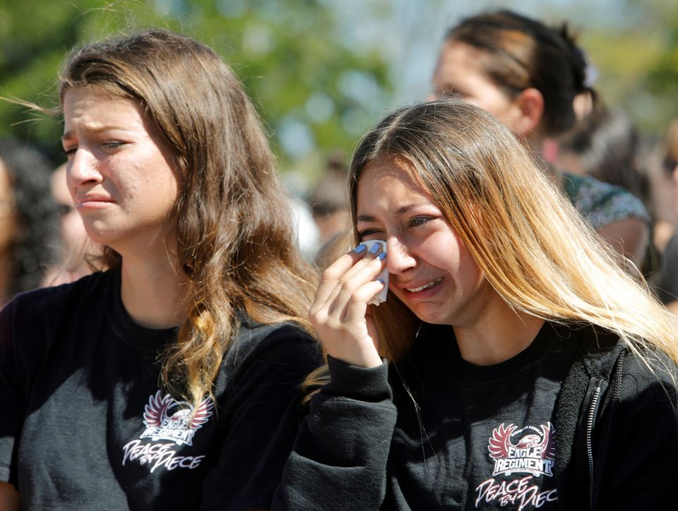 Students mourn during a community prayer vigil for victims of Wednesday's shooting.