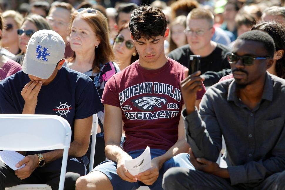 Daniel Journey, center, an 18-year-old senior at Marjory Stoneman Douglas High School in Parkland,at the vigil.