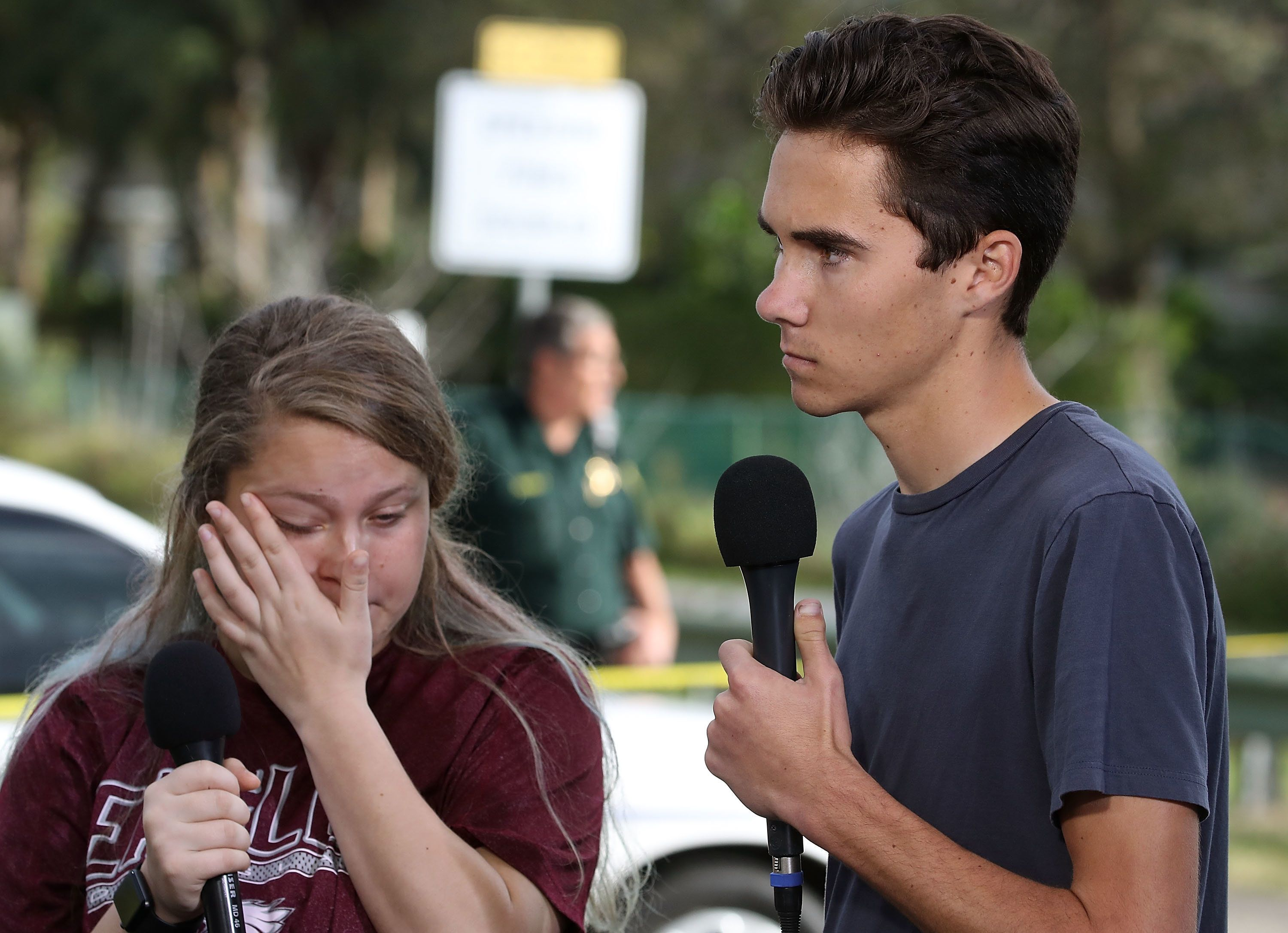 PARKLAND, FL - FEBRUARY 15: Students Kelsey Friend (L) and David Hogg recount their stories about yesterday's mass shooting at the Marjory Stoneman Douglas High School where 17 people were killed, on February 15, 2018 in Parkland, Florida. Police arrested the suspect after a short manhunt, and have identified him as 19 year old former student Nikolas Cruz.  (Photo by Mark Wilson/Getty Images)