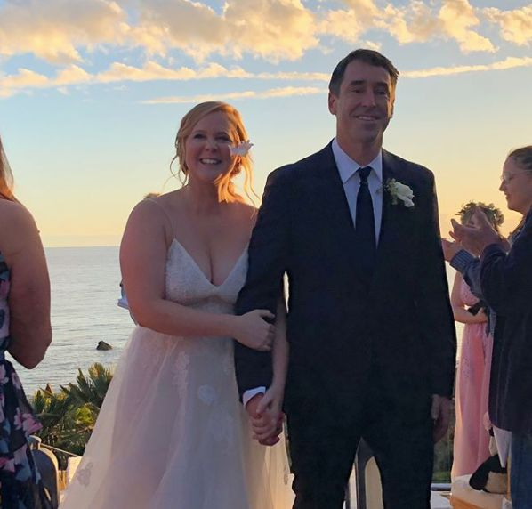 Amy Schumer  Instagram                   Schumer's enchanting Monique Lhuillier Severine Chantilly Lace and Tulle Gown can be found at Nordstrom