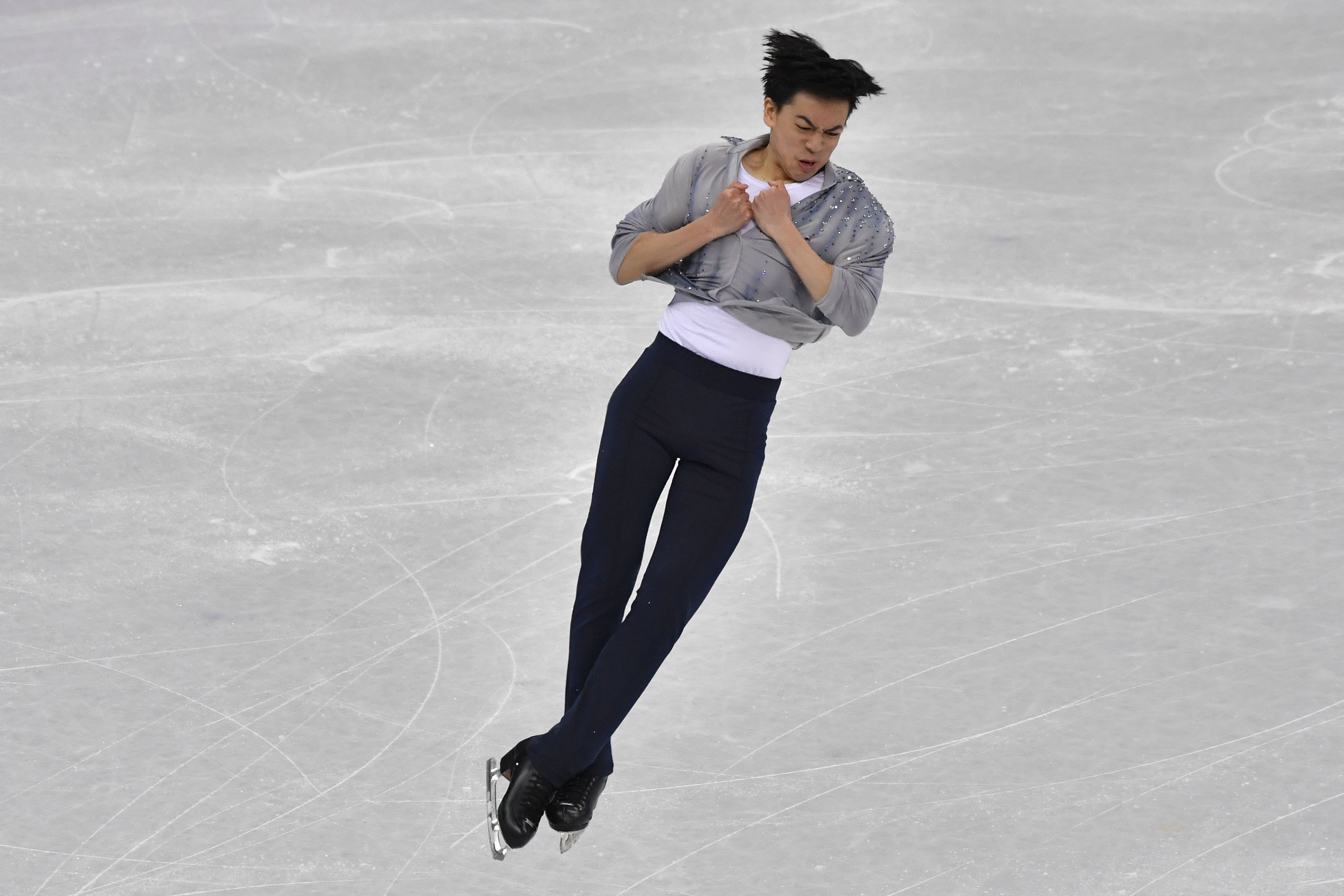 USA's Vincent Zhou competes in the men's single skating short program of the figure skating event during the Pyeongchang 2018 Winter Olympic Games at the Gangneung Ice Arena in Gangneung on February 16, 2018. / AFP PHOTO / Ed JONES        (Photo credit should read ED JONES/AFP/Getty Images)