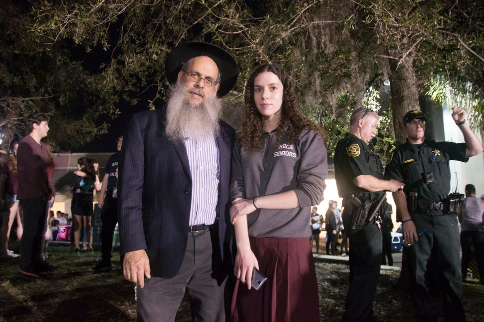 Rabbi Mendy Engel and his daughter, 18-year-old Chaya Itta Engel, came to the vigil to show their support for the f