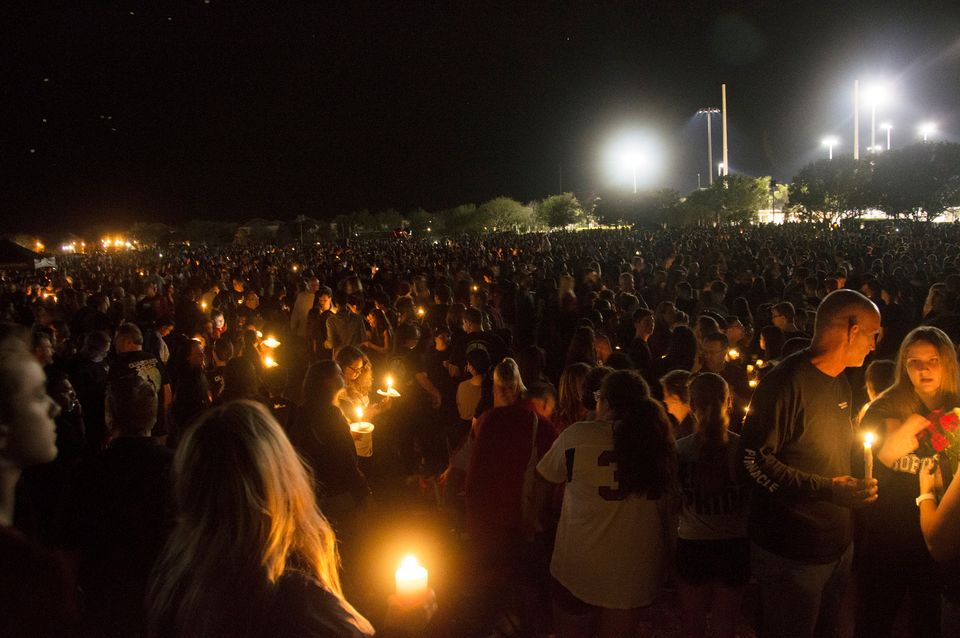 Thousands of community members gather to mourn those who died in Wednesday's school shooting in Parkland,
