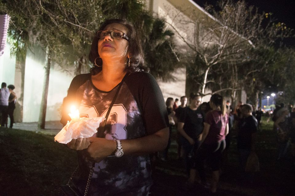 Donna Ali holds a candle at a vigil for those who lost their lives in Wednesday's school shooting in Parkland, Florida.