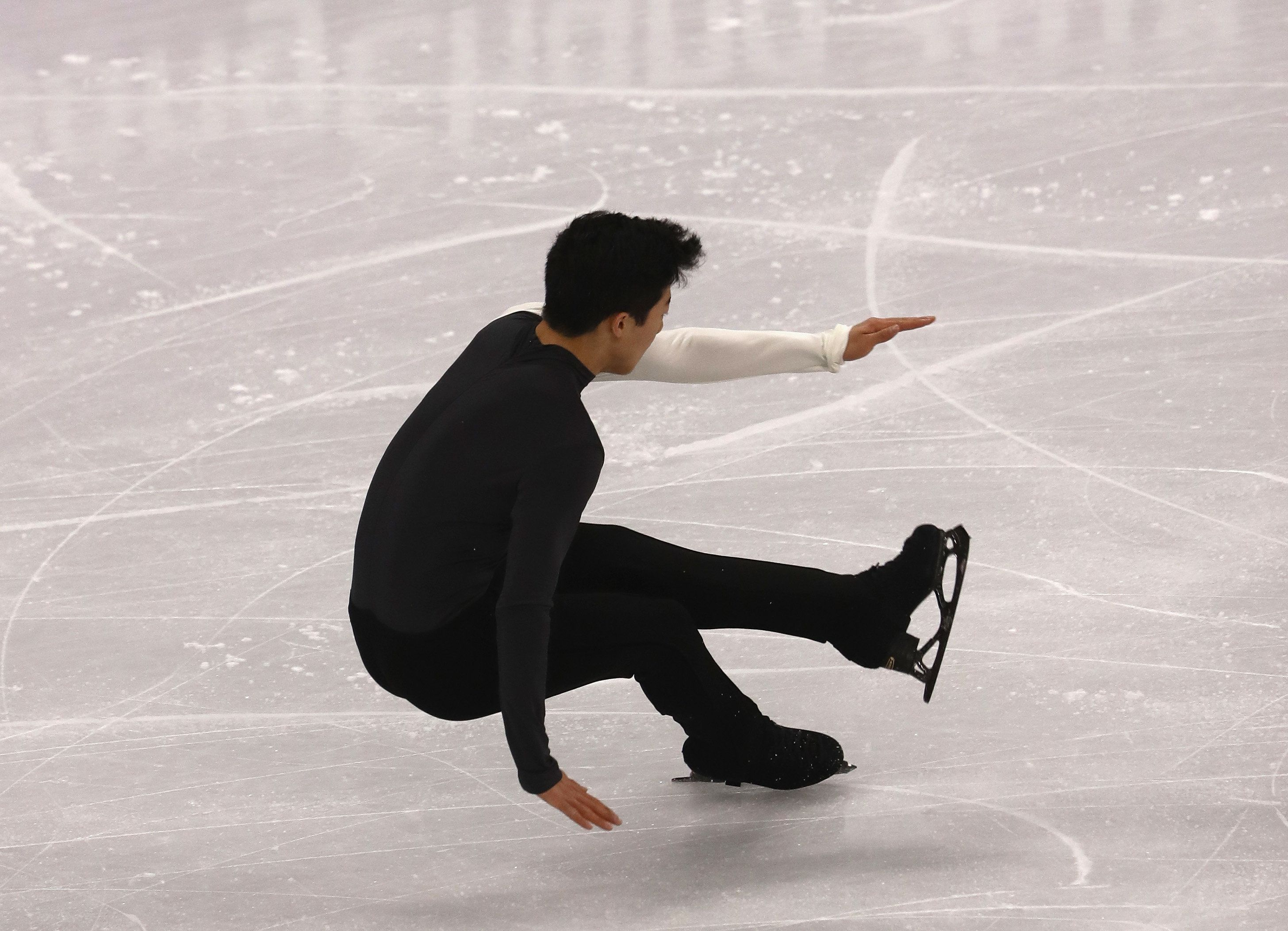 Robert Cianflone via Getty Images The mistakes kept adding up in the men's short program for Nathan Chen who's competing in his first Winter Olympics