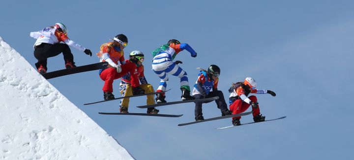 The snowboard cross final goes airborne at the Winter Olympics on Friday.