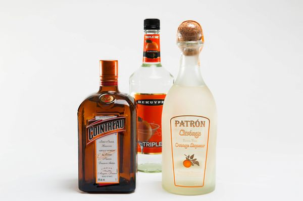 Here are the three kinds of orange liqueur we tested. From left to right, they are: Cointreau ($32), DeKuyper Triple Sec ($7)